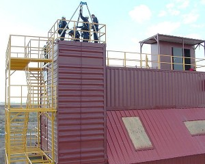 Image of firefighters training on buckeye system roof
