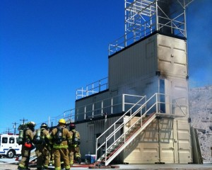 An Image of Firefighters Training With The Bullhead System