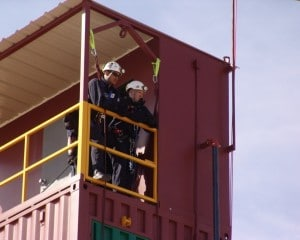 Image of firefighters leaning on guardrails