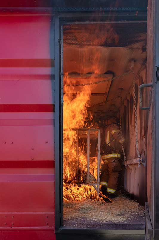 An Image of A Firefighter Training In The Burn Room Of The Bullhead System Sun Valley